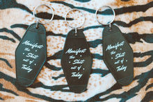 "Load image into Gallery viewer, ""Manifest The Shit Out  Of Today"" Vintage Inspired Hotel Keychain"