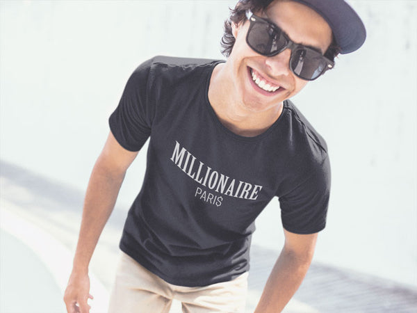 guy-wearing-a-t-shirt-smiling-at-a-skatepark - Millionaire Paris