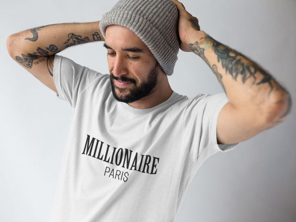 man-fixing-up-his-beanie-while-wearing-a-t-shirt-at-a-studio-Millionaire-Paris