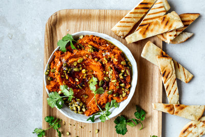 Crushed carrot dip spiced with coriander and harissa