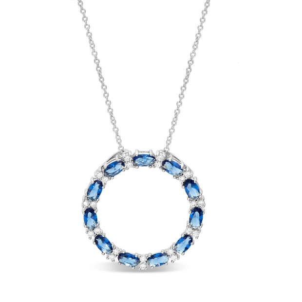 "Oval and Round Cut Prong Set Simulated Blue Sapphire and Cubic Zirconia Circle Pendant on 24"" Necklace in Rhodium Plated 925 Sterling Silver"