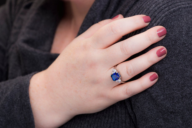 Radiant Cut Simulated Blue Sapphire and Half Moon Cubic Zirconia Ring in Rhodium Plated Silver