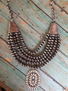 Layered navajo beaded necklace with concho