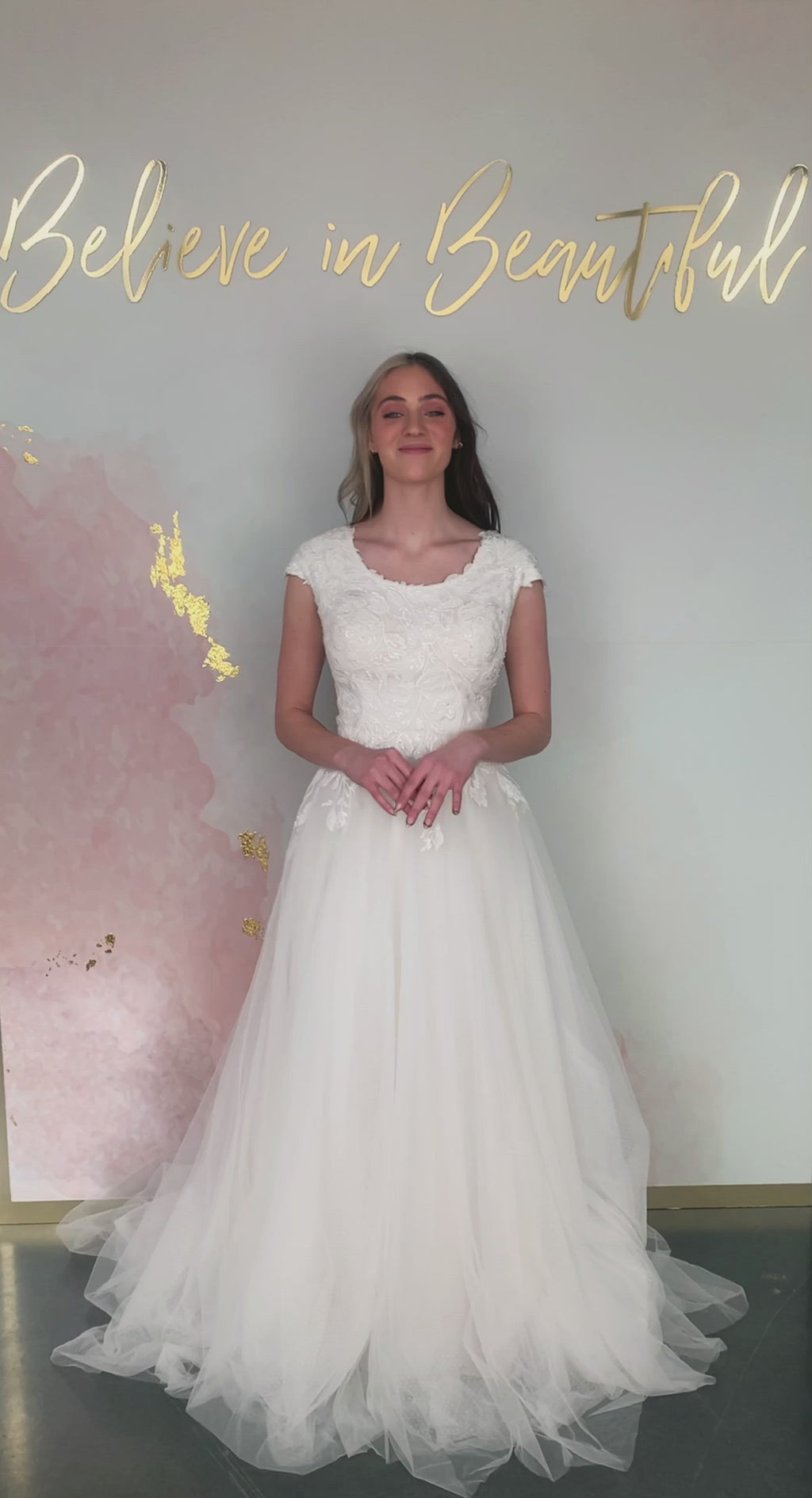 A video featuring our Amelia wedding dress with its soft A-line and floral lace detailing that trails into the skirt.