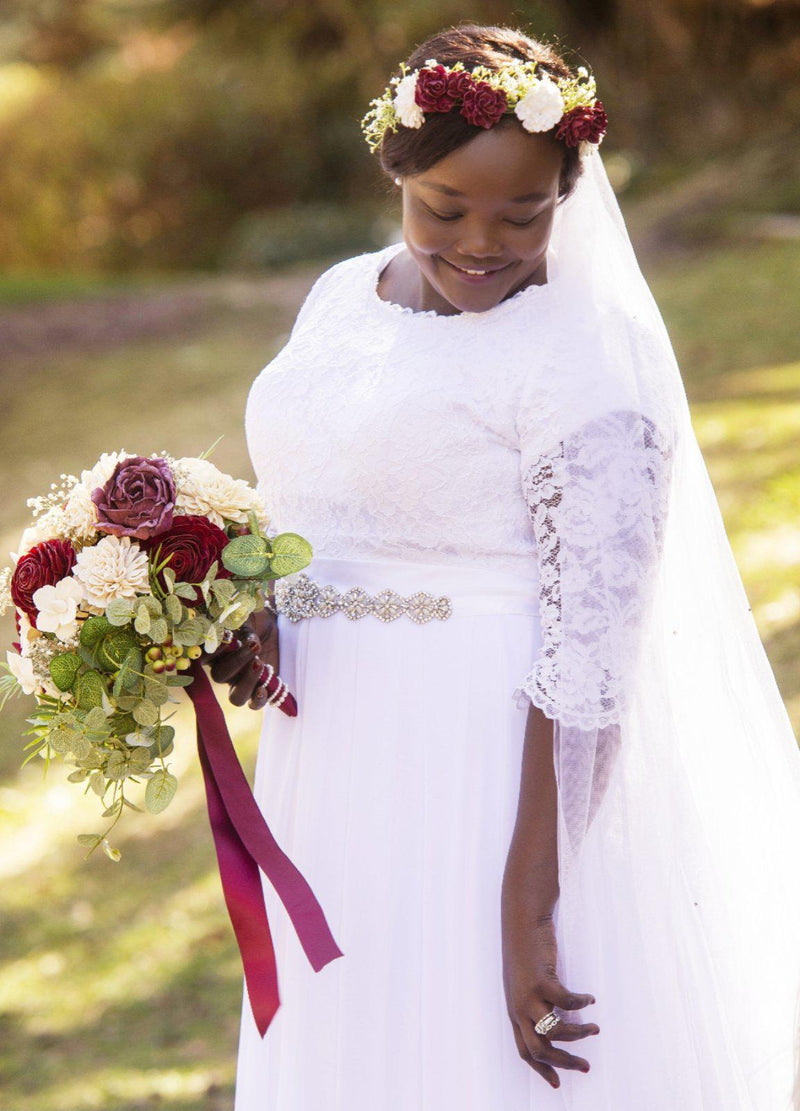 Plus size real bride wearing a Modest chiffon wedding dress,, style Haven, is part of the Wedding Collection of LatterDayBride, a Salt Lake City bridal store.
