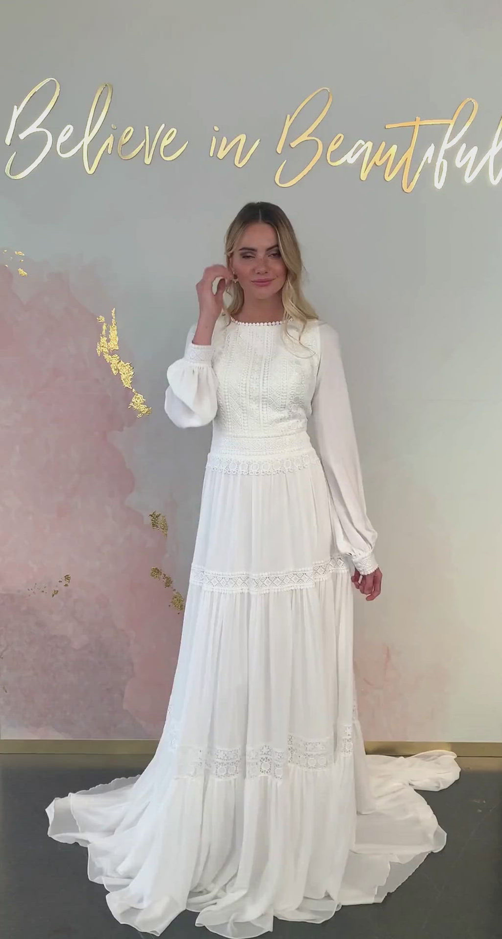 A video featuring our unique, boho Watson dress and its tiered lace skirt, and chiffon bishop sleeves.