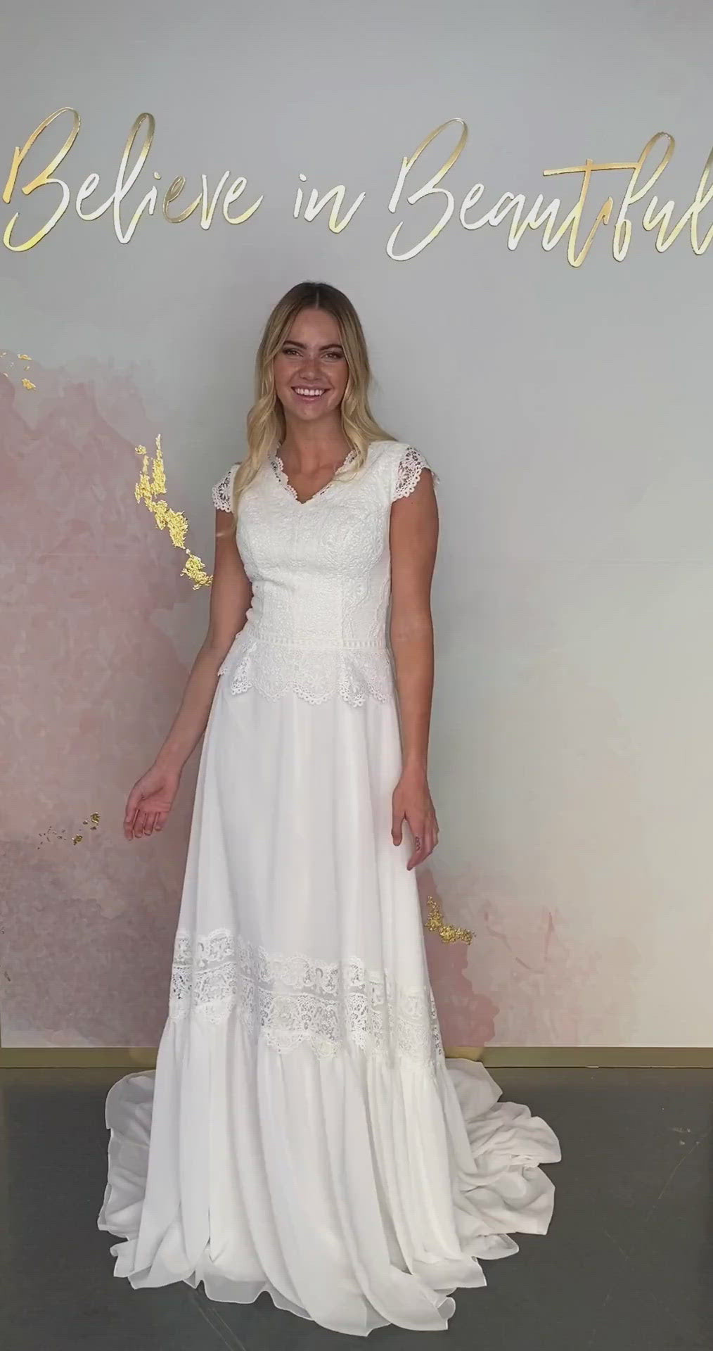A video featuring our Karina wedding dress and its boho flowy chiffon skirt with lace detailing that matches the lace in the bodice.