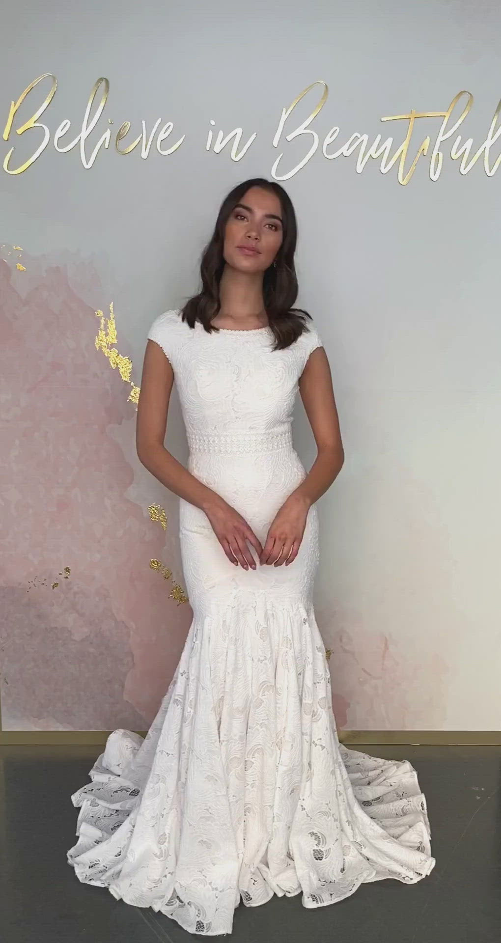 A video featuring our Janessa wedding dress and its gorgeous trumpet silhouette with cap sleeves and all-over lace detailing.