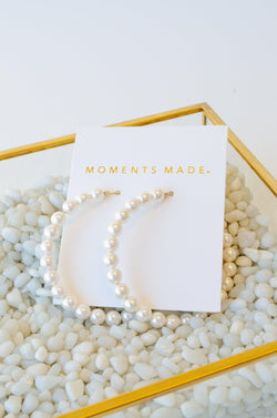 Pearls lining a medium sized hoop earring from salt lake city bridal shop