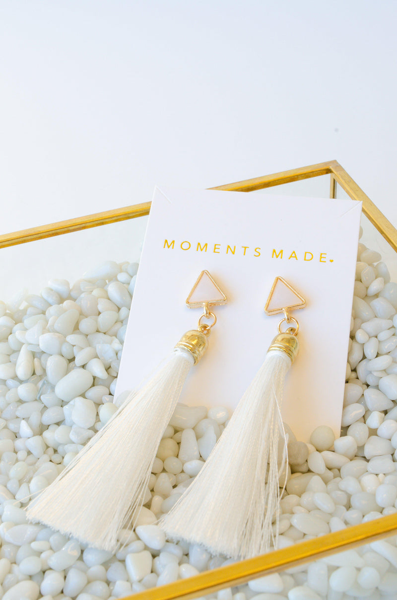 gold earrings with beige tassels complimented with triangles from Salt Lake City Bridal Shop