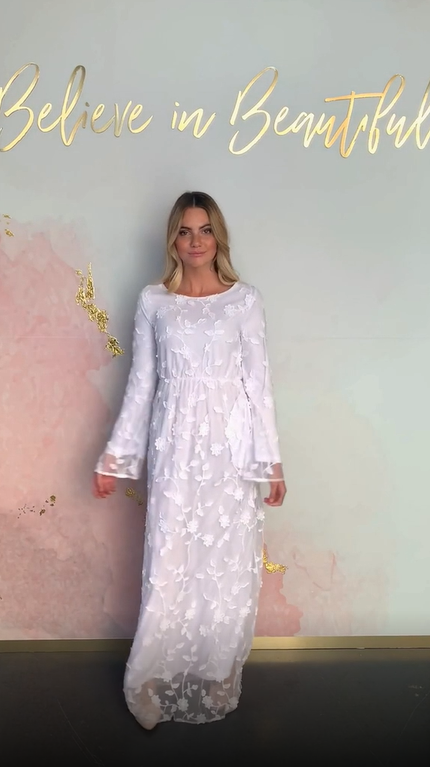 A video featuring our Kona temple dress and highlighting its unique embroidered lace pattern, and beautiful sleeves.