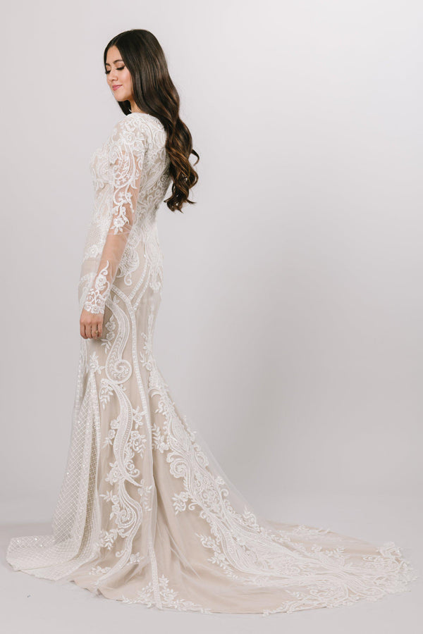 Modest wedding dress with geometric and basket-weave lace patterns that hug natural curves of the body at every angle.