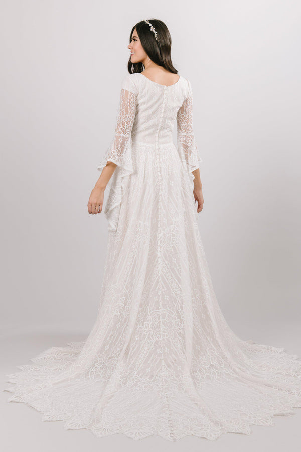 modest wedding dress Soft a-line laced dress with quarterly length flowing sleeves from salt lake city utah bridal shop