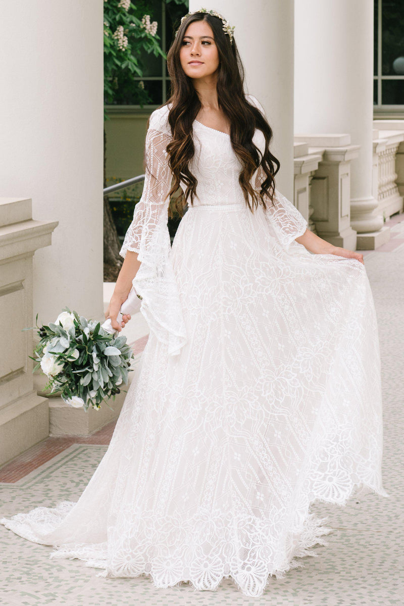 Modest wedding dress, Soft a-line laced dress with quarterly length flowing sleeves from salt lake city utah bridal shop