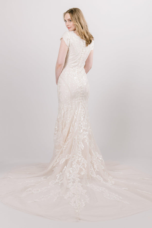 Fit and Flare modest wedding dress that has a leafy lace and sequins from salt lake city utah bridal shop