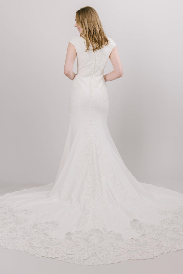 Soft fit and flare dress with beading on the top that moves down the modest wedding dress at salt lake city bridal shop
