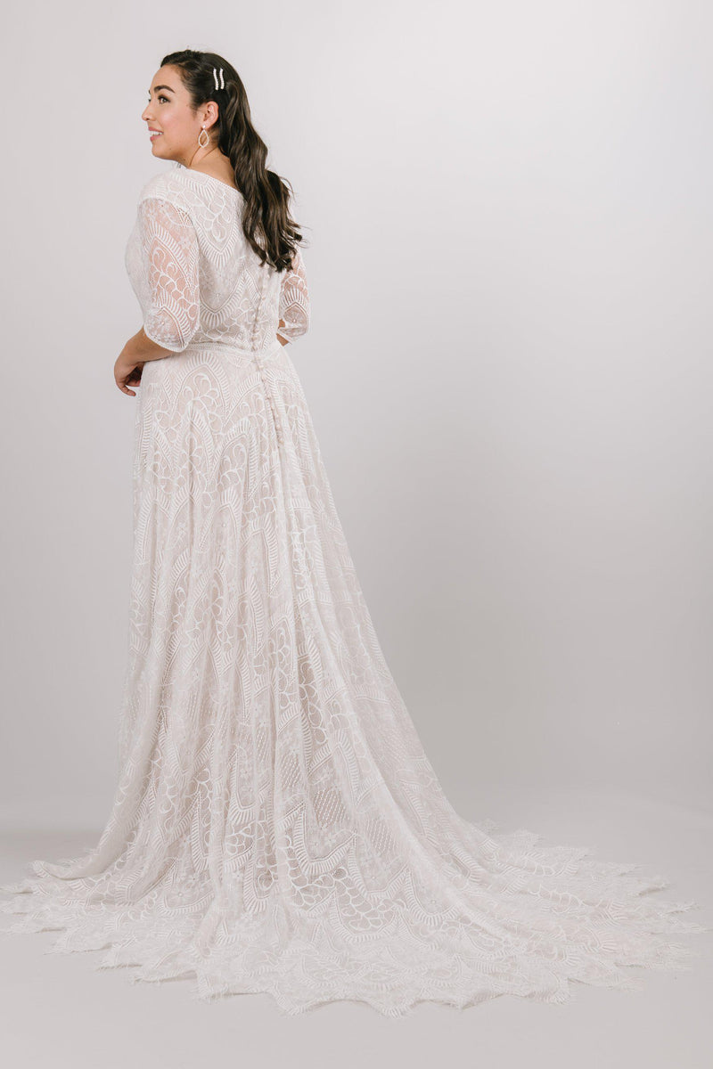 Back view of a modest wedding ballgown with lace details from LatterDayBride, a modest wedding dress shop in Salt Lake City, Utah
