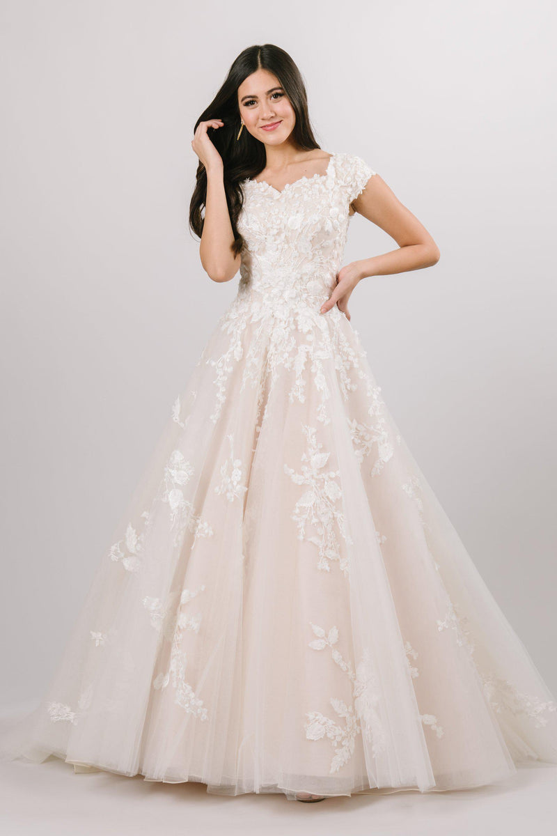 classic modest ballgown wedding dress features a breathtaking sweetheart neckline and off-shoulder sleeves, delicately covered in blooming 3D floral lace. Available in White/White/White, Champagne/Nude/Ivory, Ivory/Ivory/Ivory, Silver Blush/Nude/Ivory