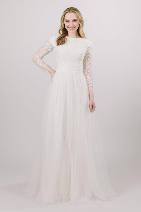 Modest soft aline wedding dress features a illusion, laced quarter length sleeve from bridal shop in Salt Lake City Utah
