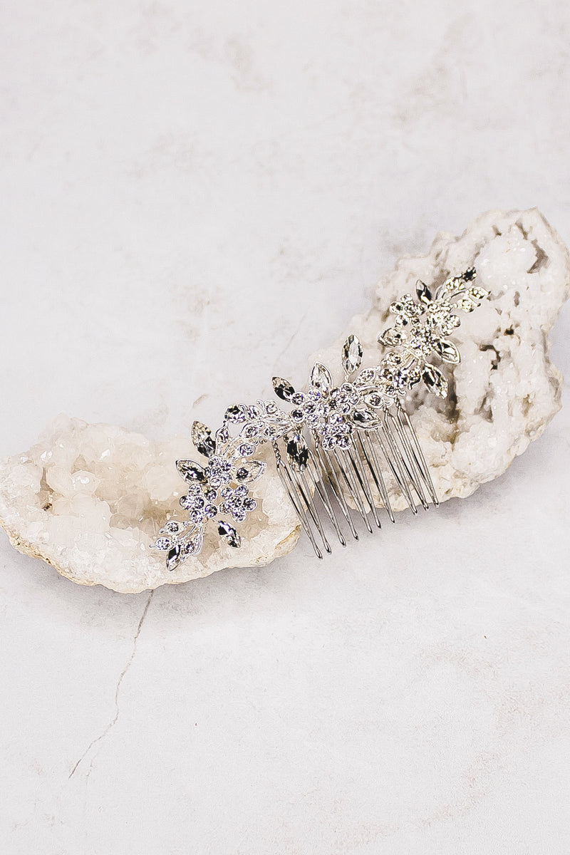Petite comb of rhinestone flowers and marquise leaves  Available silver.
