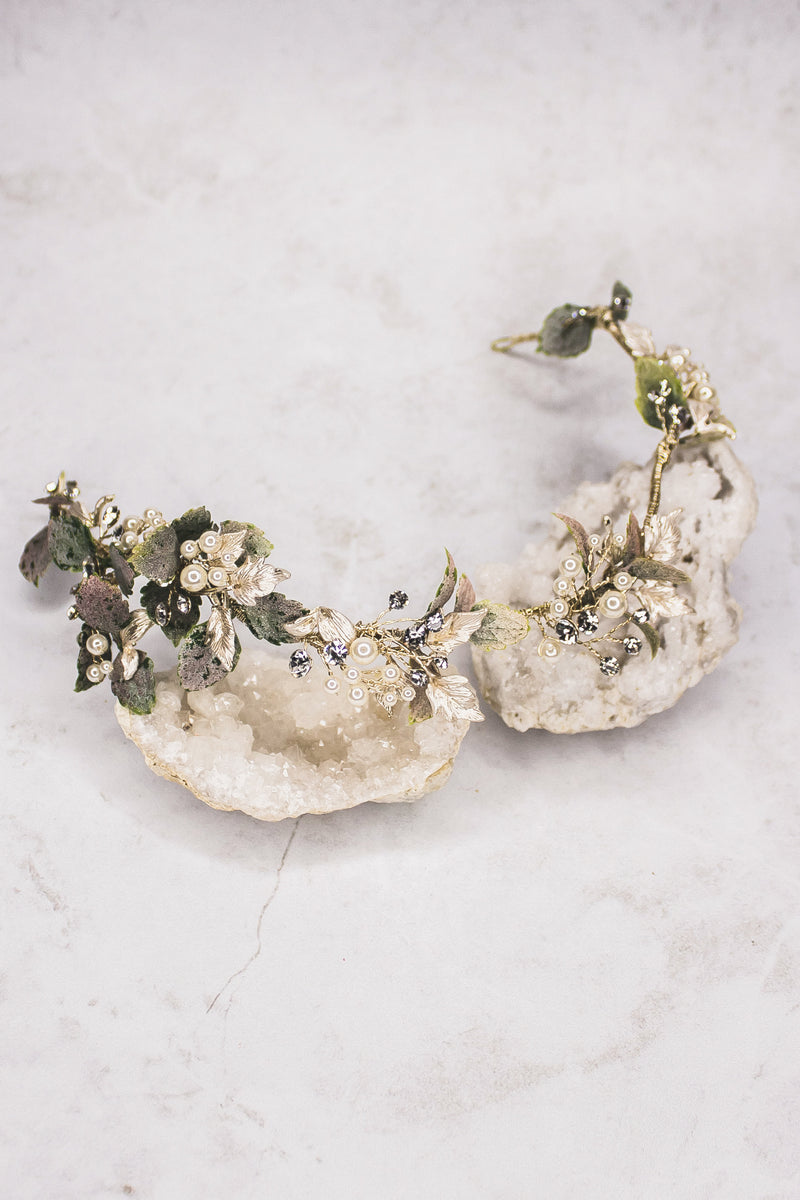 Nature-inspired headband with greenery  Create a luxurious bohemian style with a natural-looking leaf headband. Abundant greenery, metallic leaves, faux pearls, and glittering rhinestones create a beautiful, everlasting design. It may be worn as a headband or in the back of an updo.