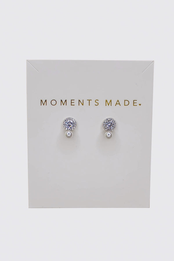 Simple and gorgeous, our earrings feature a round cut crystal, surrounded by a crystal halo, and then finished with a single white pearl. Beautiful gift for your significant other or bridesmaids.