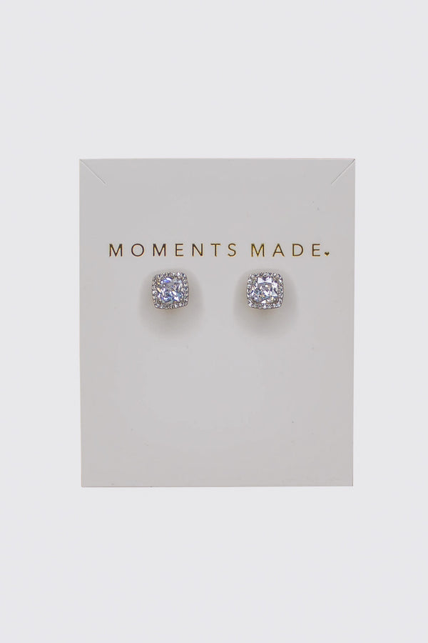 The earring is a cushion-cut crystal with a halo design.