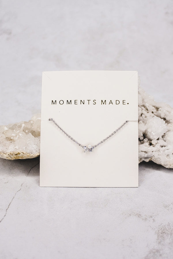 This necklace is a dainty, charming piece that features a pearl, with marquise and circle crystals. It adds a gorgeous, elegant touch to your everyday look. From a bridal shop in SLC, Utah