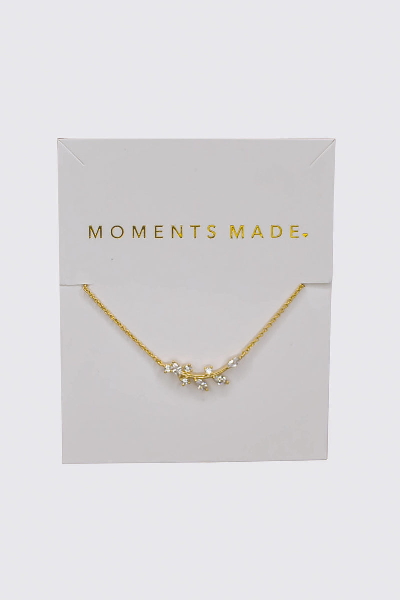The gold necklace features an alluring array of leaf marquise-cut crystals. This necklace is charming and great for layering! From a SLC bridal shop in downtown!