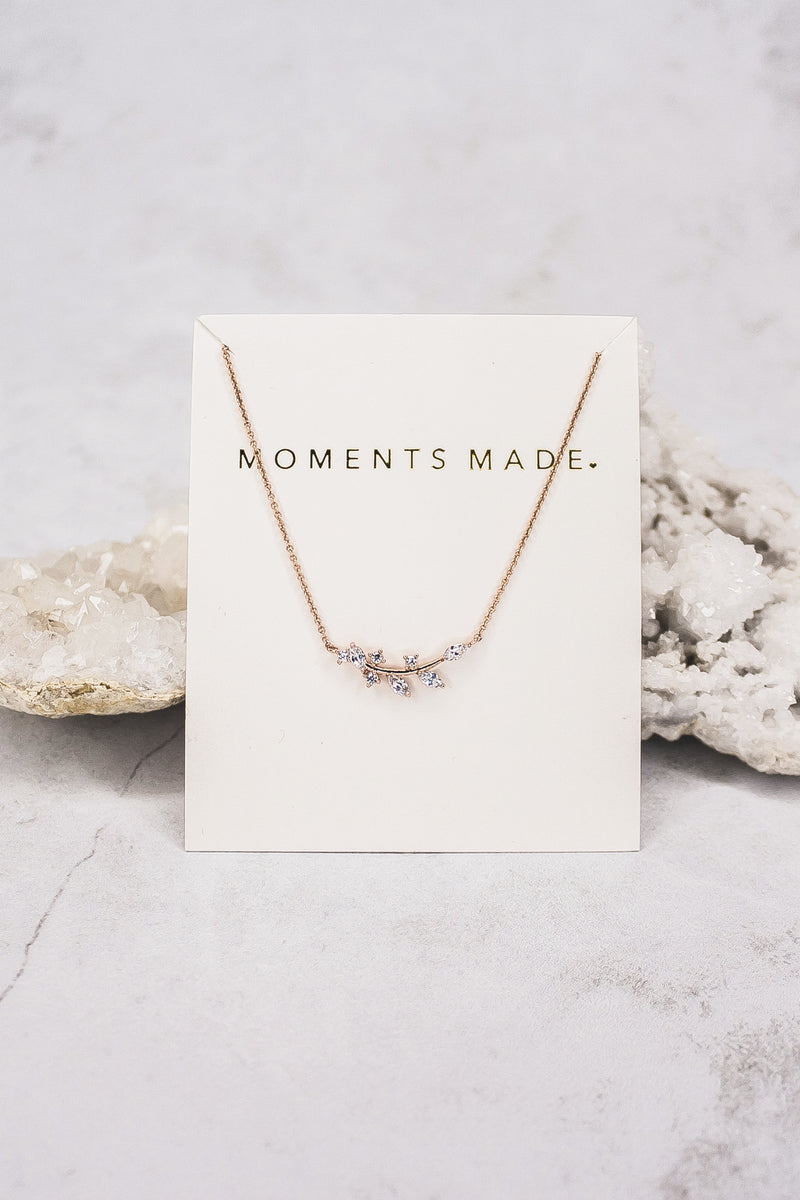 The necklace features an alluring array of leaf marquise-cut crystals. This rosegold necklace is charming and great for layering! From LatterDayBride in Salt Lake City, Utah.