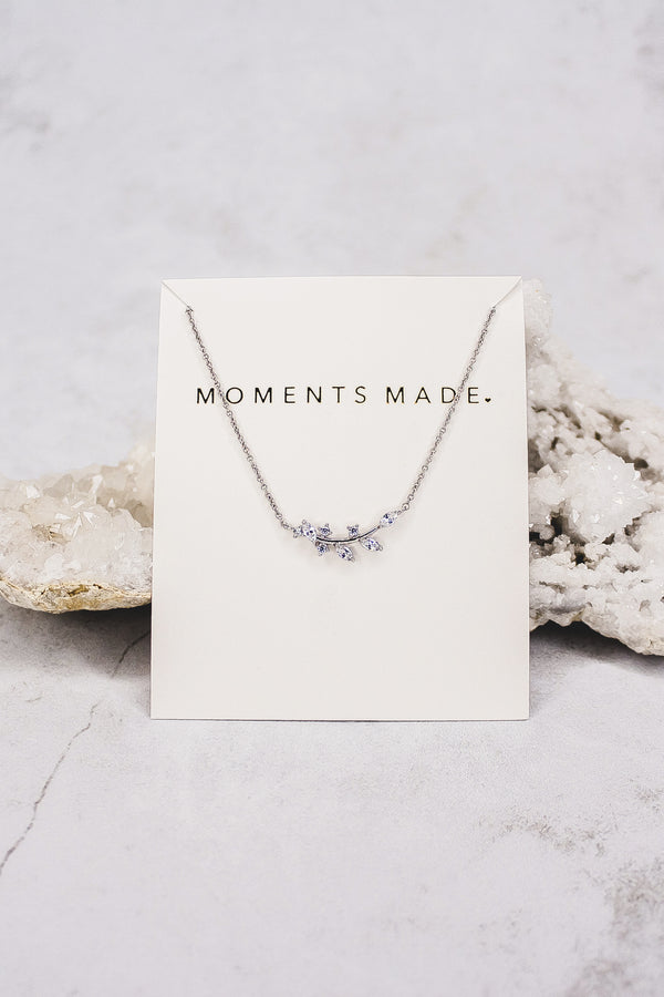 The necklace features an alluring array of leaf marquise-cut crystals. This necklace is charming and great for layering! From a bridal store in SLC, Utah