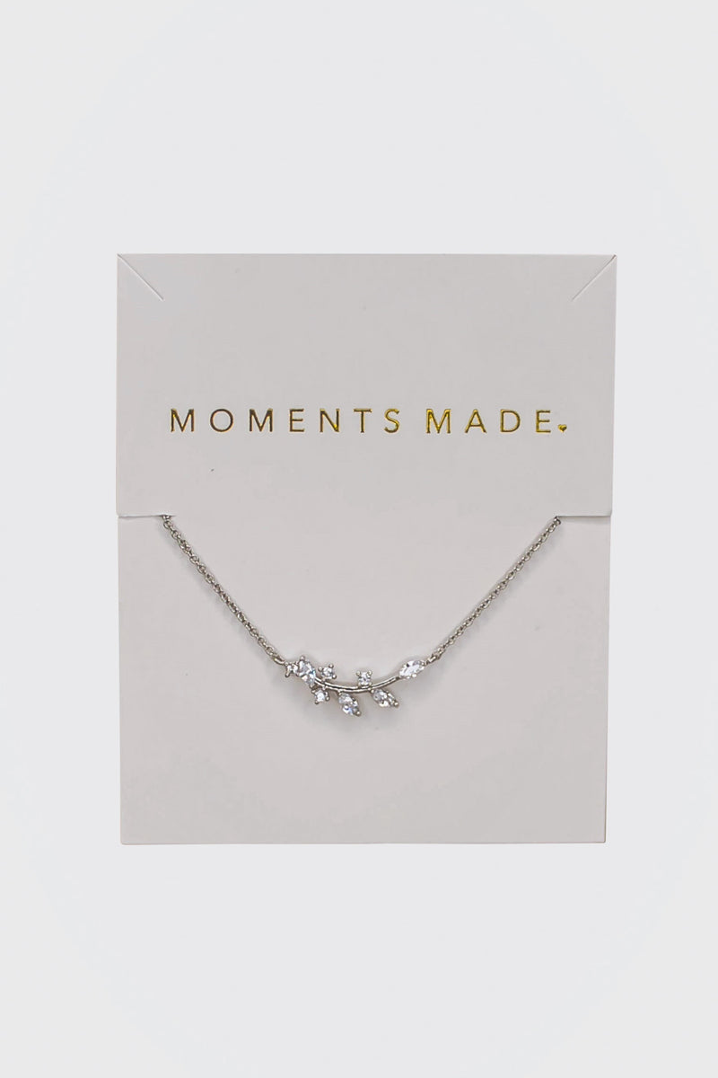 The necklace features an alluring array of leaf marquise-cut crystals. This necklace is charming and great for layering!