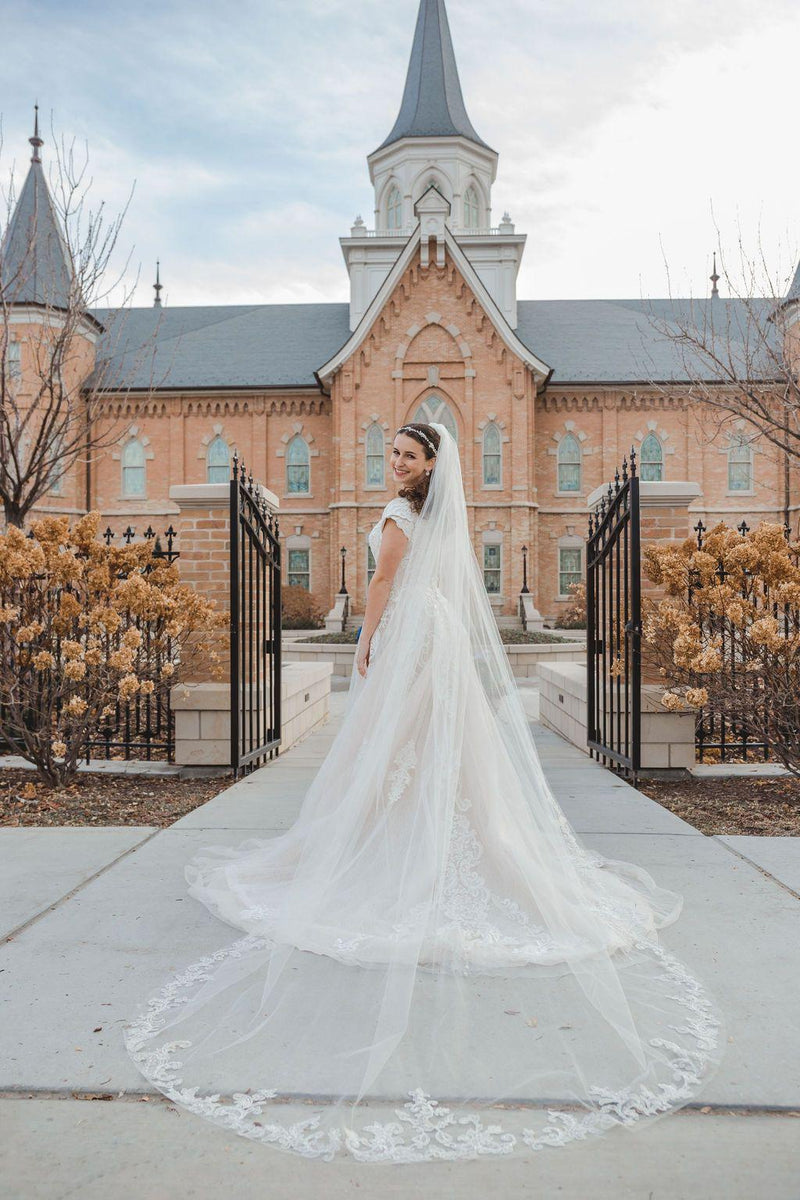 Back view of a modest wedding ballgown with cathedral length veil. From LatterDayBride, a modest wedding dress shop in Salt Lake City, Utah