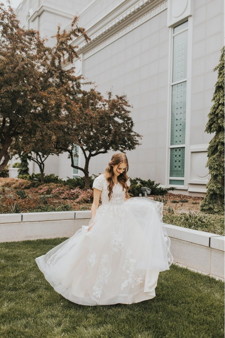 Real Bride wearing a Modest Wedding Gown from LatterDayBride, new lace, coupled with a dainty v-neck and a modified A-line skirt, modest wedding dress, salt lake city, back view