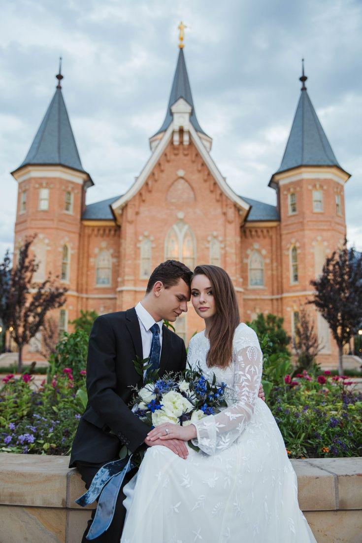Real Bride wearing a long sleeve modest wedding dresses with embroidery and flowing skirt, the Lindir at LatterDayBride