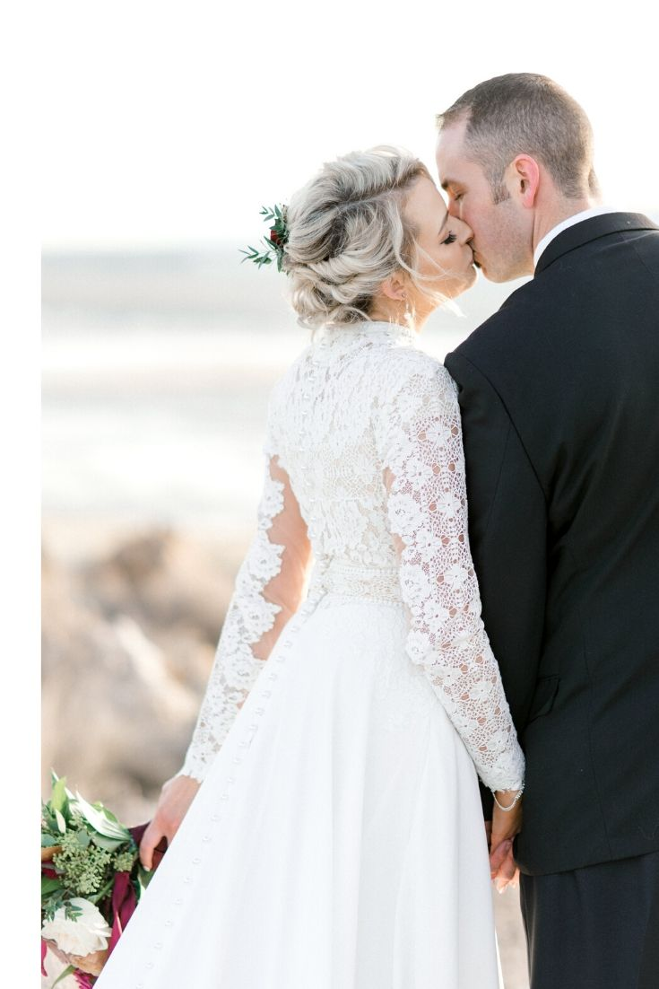 Real Bride wearing a modest wedding dress with a lace bodice from LatterDayBride, a modest wedding dress shop in Salt Lake City, Utah.