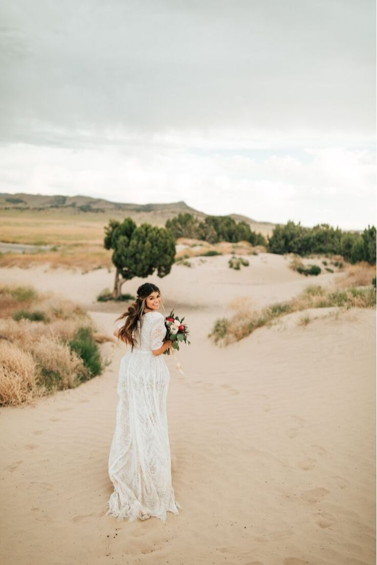 Real bride wearing a modest lace wedding dress with long sleeves from LatterDayBride, a bridal shop in Downtown Salt Lake City, Utah.