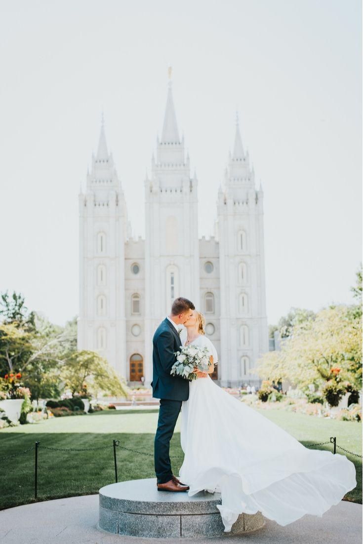 Real bride wearing an A Line modest wedding dress from LatterDayBride, a bridal shop in Salt Lake City, Utah.