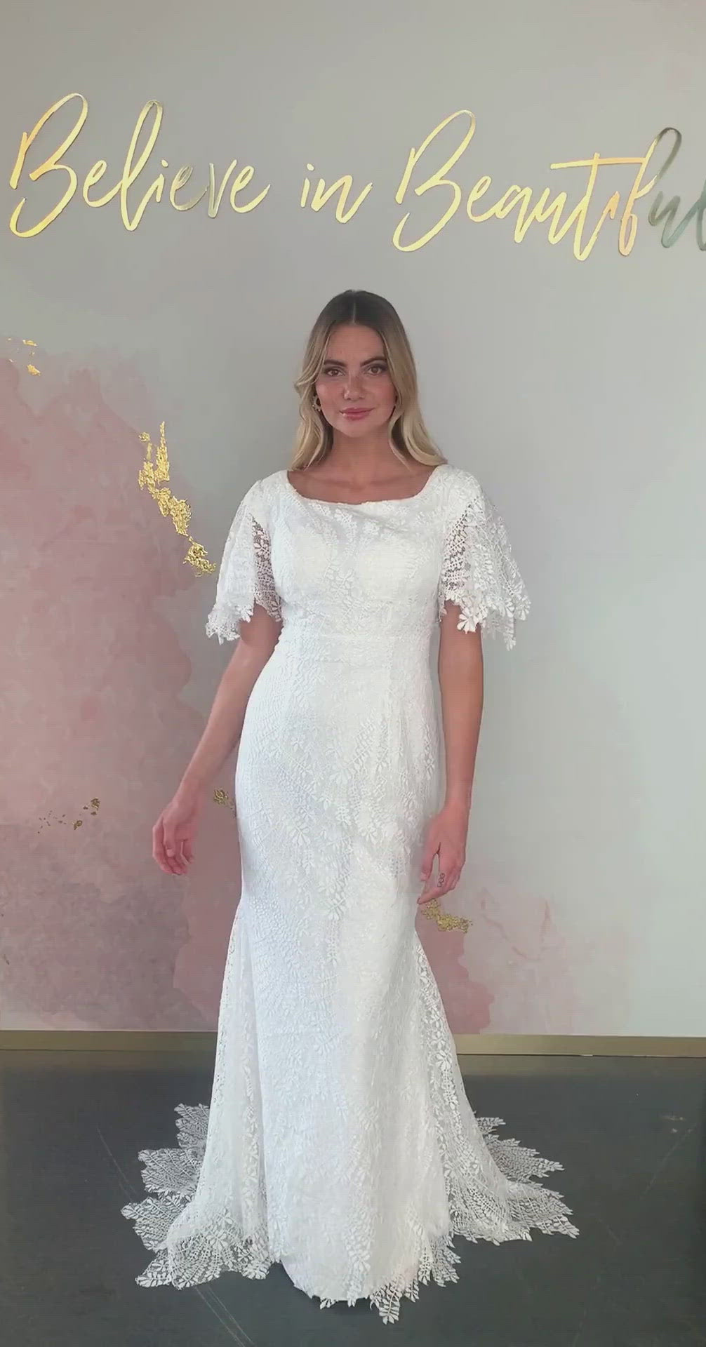 A video featuring our Atwood wedding dress and its boho lace pattern, square neckline, and lace flutter sleeves.