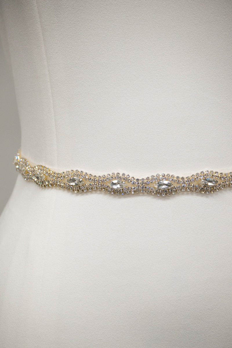 Close up view of a Minimal bridal belt from LatterDayBride, a bridal shop in Salt Lake City, Utah.