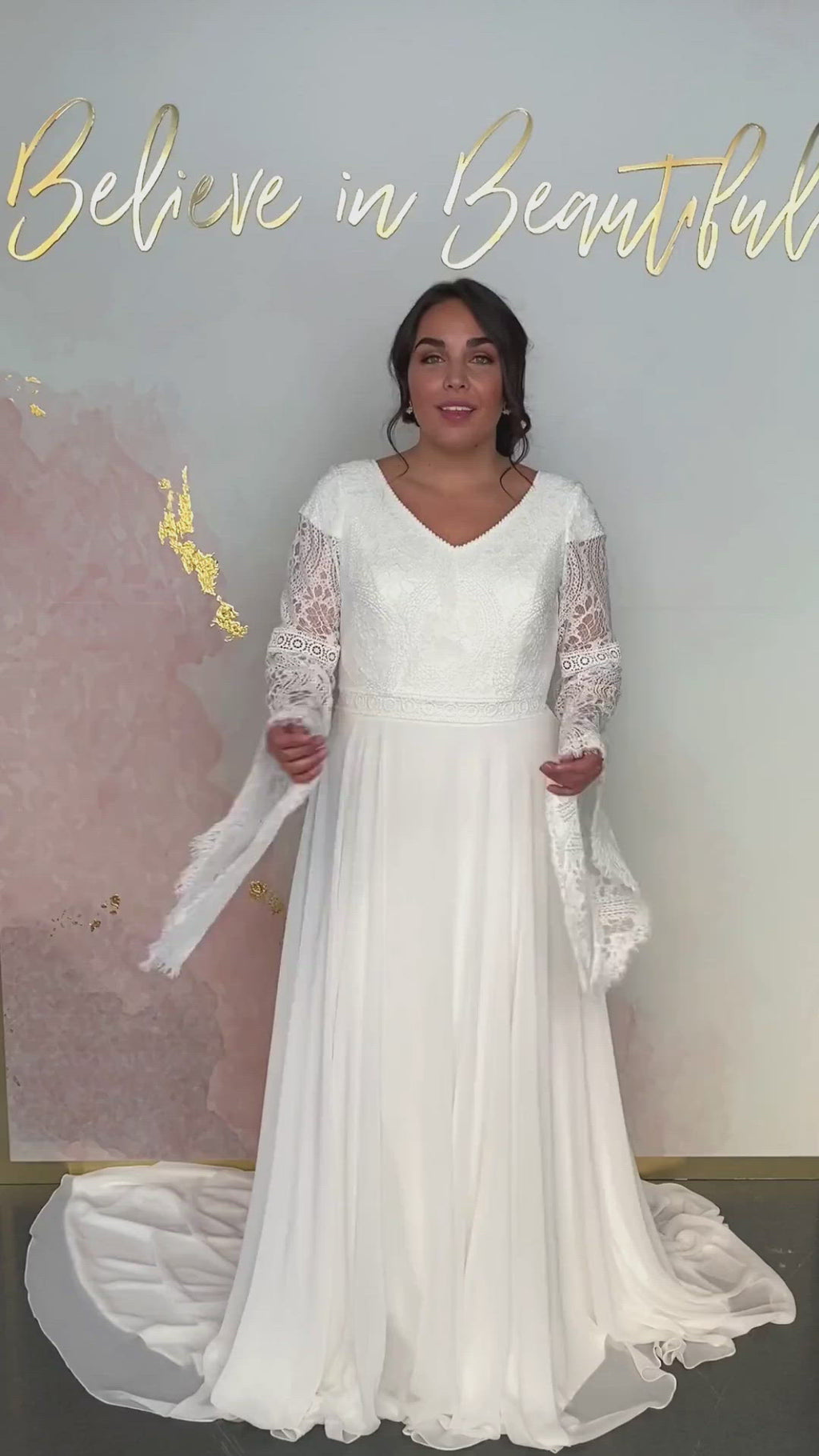 A video featuring our Merida wedding dress and its billowing lace bell sleeves, and flowy chiffon A-line skirt.