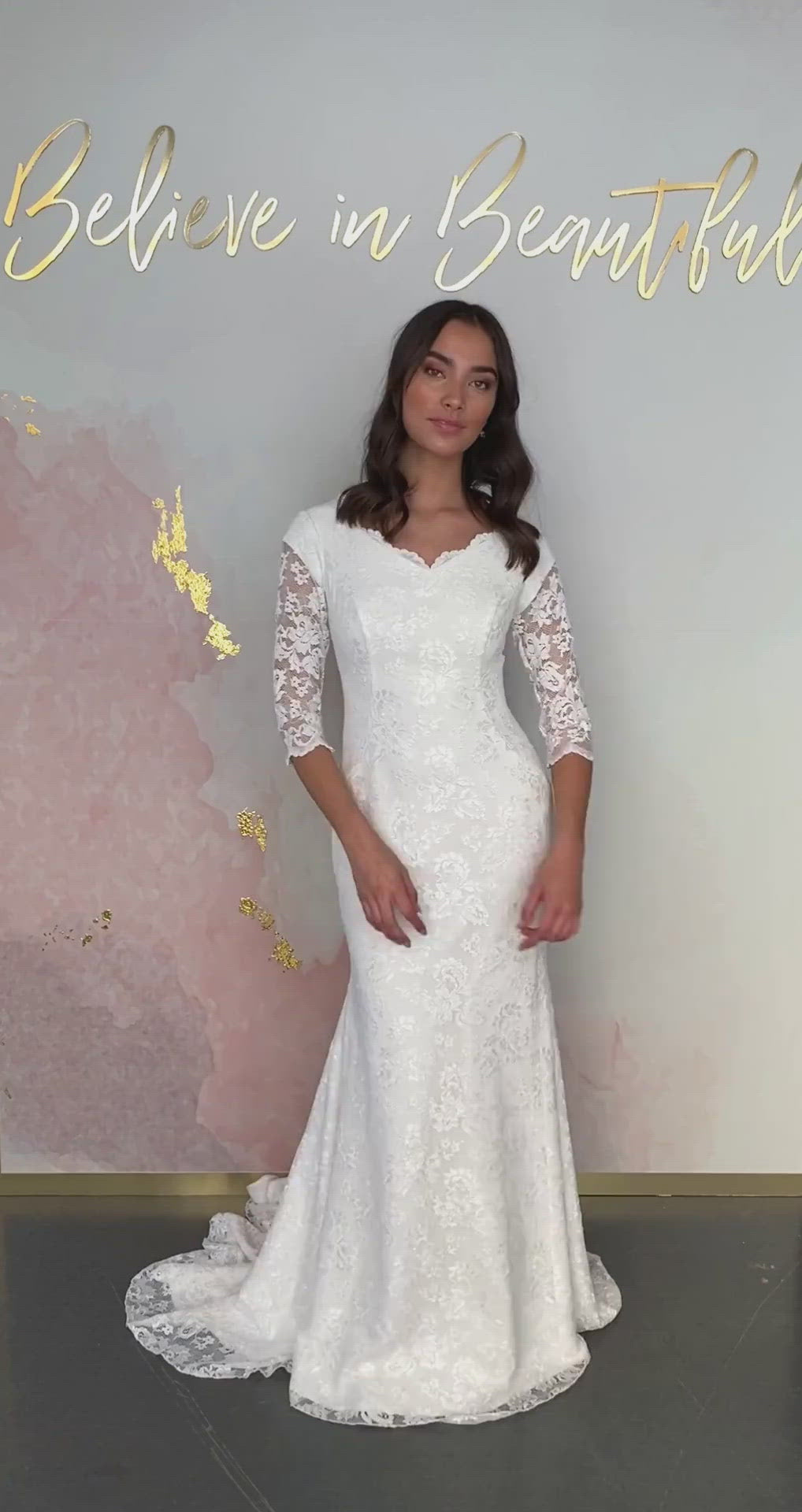 A video featuring our Amanza wedding dress and its sheath fit with all-over Chantilly lace and scalloped neckline detailing.
