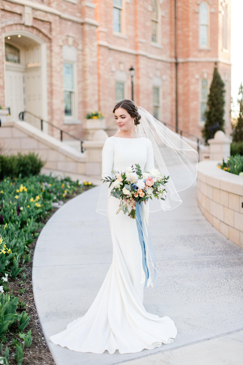 Real Bride wearing a Modest long sleeve bridal gown, style Markella, is part of the Wedding Collection of LatterDayBride, a Salt Lake City bridal shop.