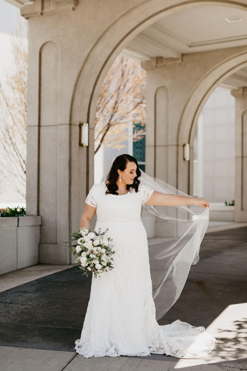 Plus size real bride wearing a lovely modest wedding dress with lace, style Palisade, is part of the Wedding Collection of LatterDayBride, a Salt Lake City bridal store.
