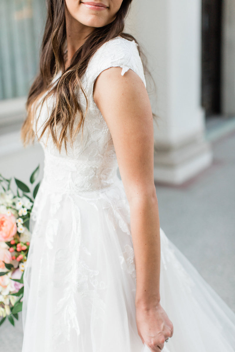 Real bride wearing a modest modern ballgown from LatterDayBride, a modest bridal shop in Downtown Salt Lake City, Utah.