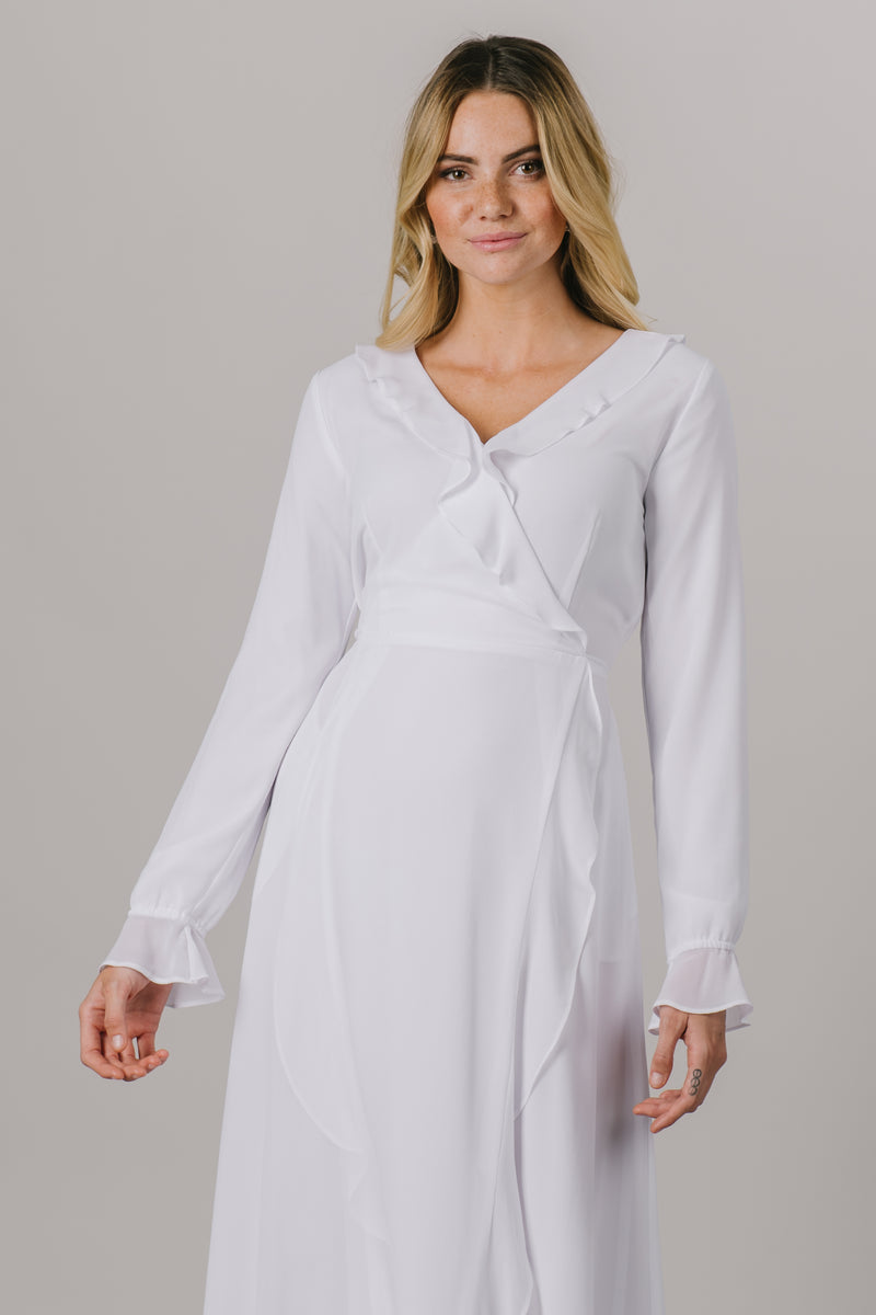 A close up of our Lindon Temple dress. This LDS temple dress features a fully lined flattering wrap dress. It includes two pockets and a side zipper closure.