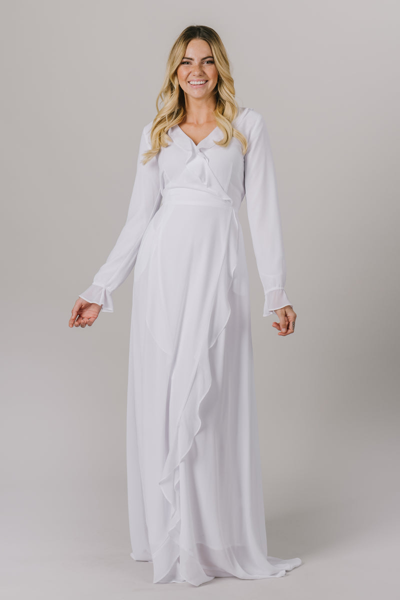 This LDS temple dress features a fully lined flattering wrap dress. It includes two pockets and a side zipper closure.