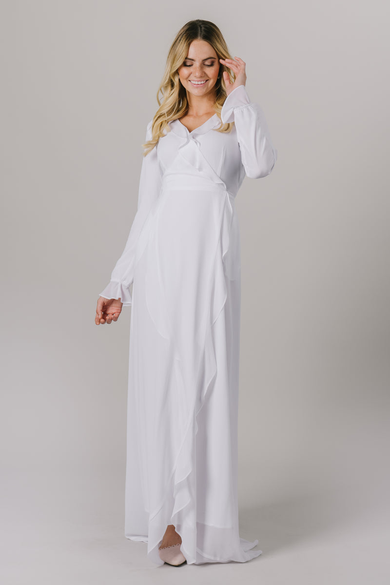 This LDS temple dress features a fully lined flattering wrap dress. It includes two pockets and a side zipper closure. From a local downtown SLC, Utah bridal store.