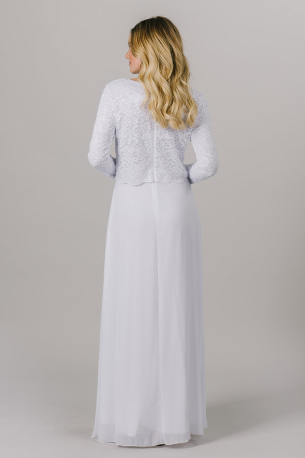 This LDS temple dress features a fully lined, loose lace bodice with a flattering waistband. It includes two pockets and a zipper close. From a bridal shop in downtown Salt Lake City.