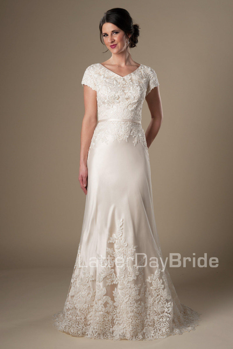 modest wedding dress features a v-neckline, delicate lace sleeves and a fabulous draping sheath silhouette finished with wide lace scalloping, modest wedding gowns, salt lake city, front view